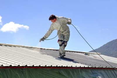 man-doing-commercial-painting-on-roof-top